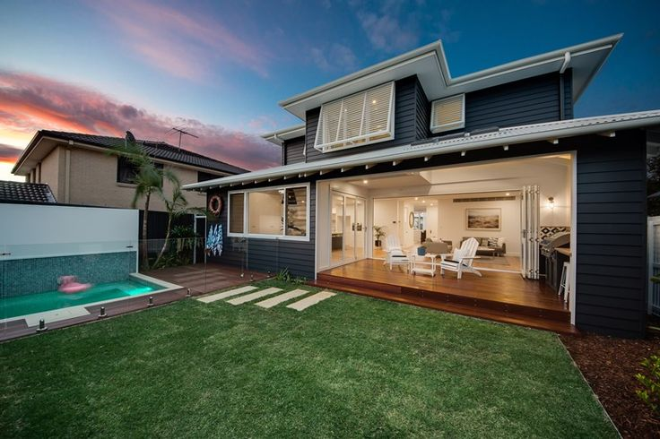 Contemporary Beach house Sydney   beach house   coastal architecture   contemporary home   Hampton style   modern Hamptons style   beach Kitchen   timber floors   weatherboard home   panelled ceiling   Hampton architecture   white windows   dark cladding   clad house   sandstone fence  