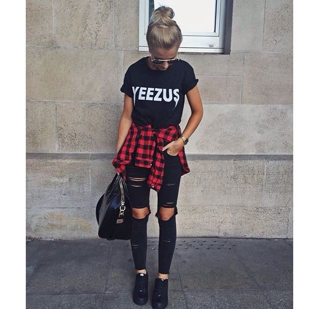 Ripped black jeans, red flannel around the waist, black top with white print
