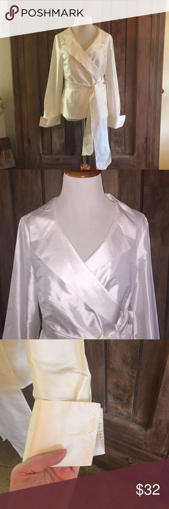 """Ann Taylor 100% Silk Wrap Excellent condition wrap around silk shirt. Tie waist. Fabric covered buttons. Missing cuff links, but those are easily replaceable and customized to your desire. Has been freshly dry cleaned. Empire waist cut and bust darts for flattering fit. Bust 33"""", waist 32"""". ID 1101 Ann Taylor Tops Blouses"""