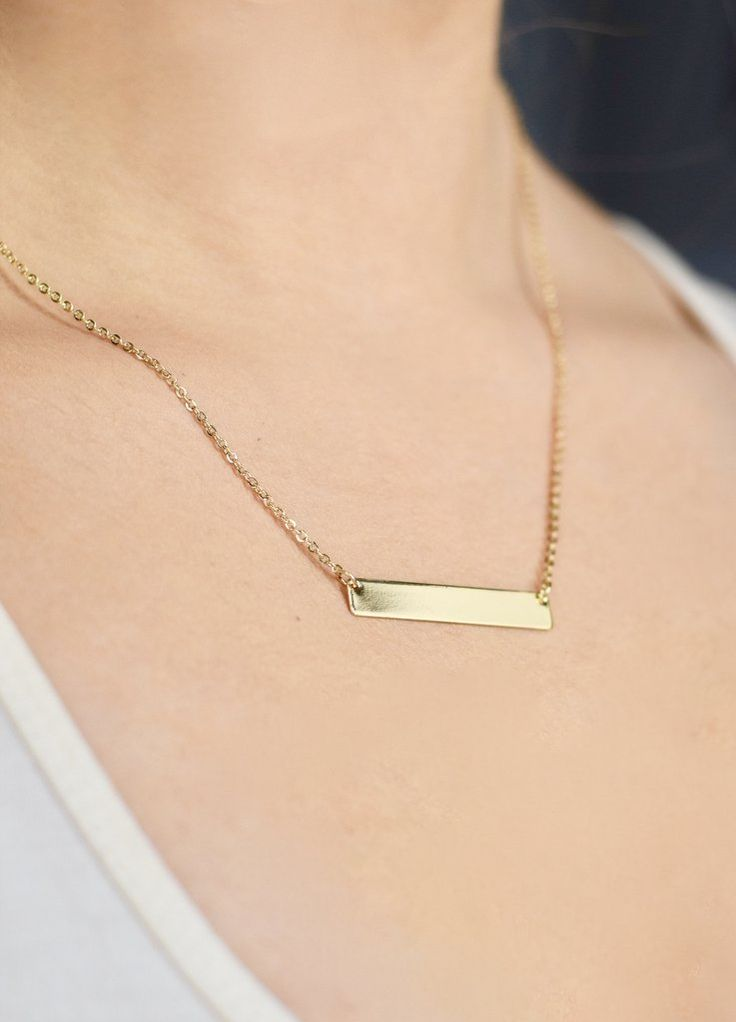 A dainty gold bar necklace adds a little touch of simple and pretty to any outfit. Chain measuring 19.5 inches.