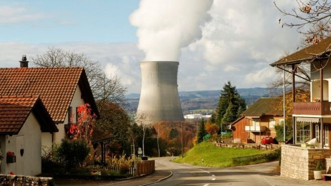 Will Swiss vote to phase out nuclear power?  Steam emerges from a cooling tower of a nuclear power plant near Leibstadt in Switzerland (24 November 2016)