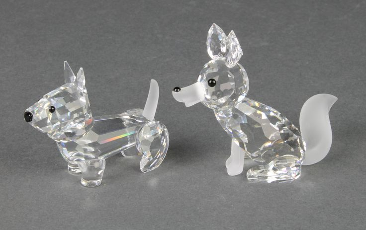 """Lot 62, A Swarovski figure of a terrier 2"""" and a ditto of a seated fox 2 1/2"""", boxed, est £30-60"""