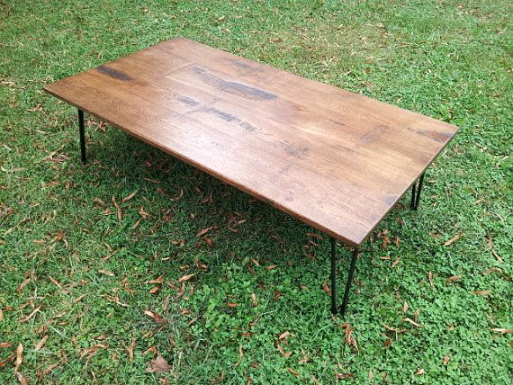 Rustic Wood Coffee Table. Wood top and metal legs for a great modern industrial look. This is a large sized coffee table for plenty of