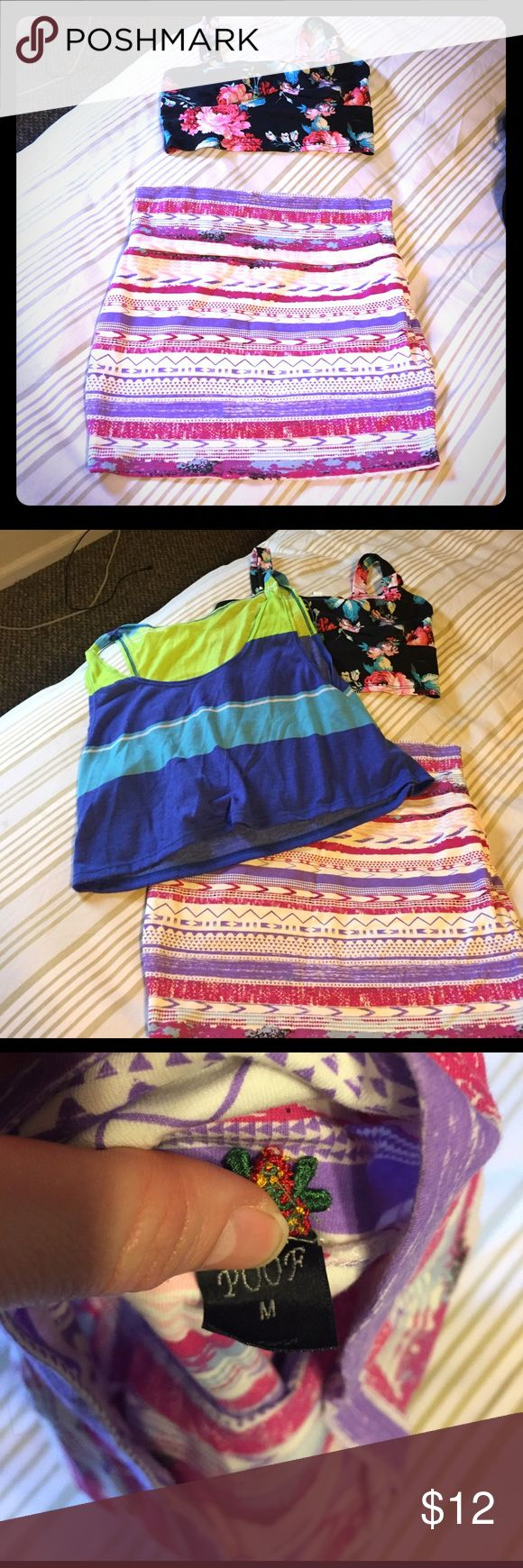 Skirt and crop top bundle Super cute Aztec print skirt with flowery crop top. The skirt is a size medium and the top is a small. I am also throwing in another crop top just for free! They have been worn a couple of times but in great condition Skirts Mini