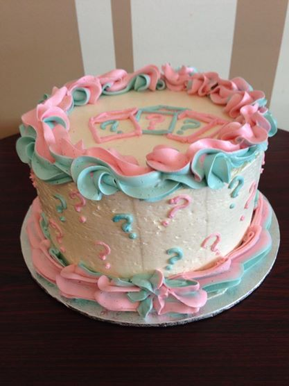 Baby Gender Reveal Cake! Not even the parents knew what was in the envelope. Inside it's ombre either pink or blue with either strawberry or blueberry buttercream. Decorated with Swiss Meringue Buttercream. How fun!
