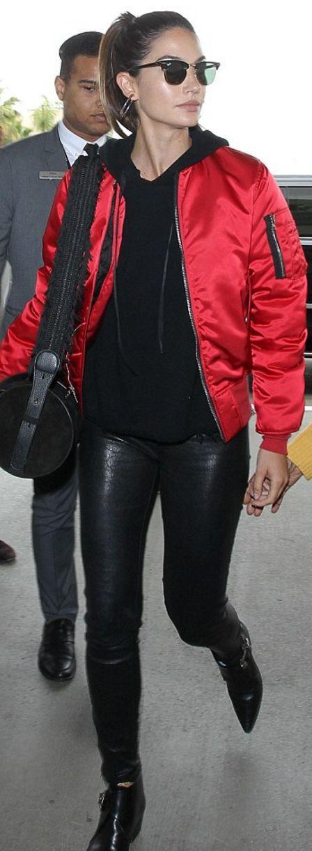Who made Lily Aldridge's black jacket, sunglasses, leather pants, fringe handbag, and red bomber jacket?