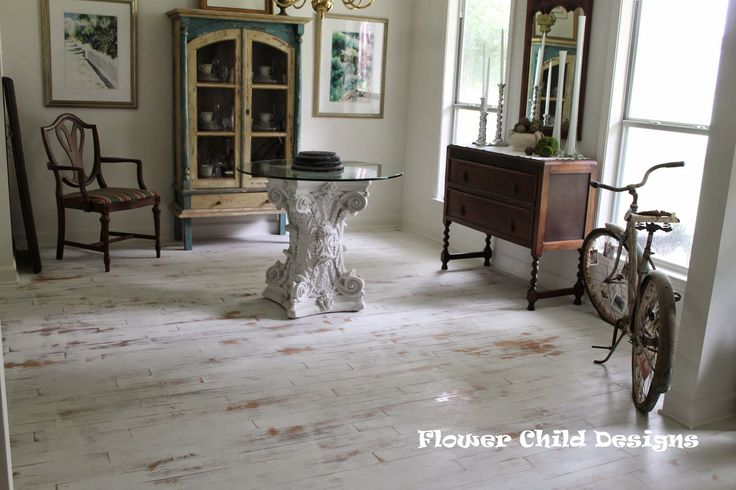 25 best ideas about distressed hardwood floors on for Painting wood floors without sanding
