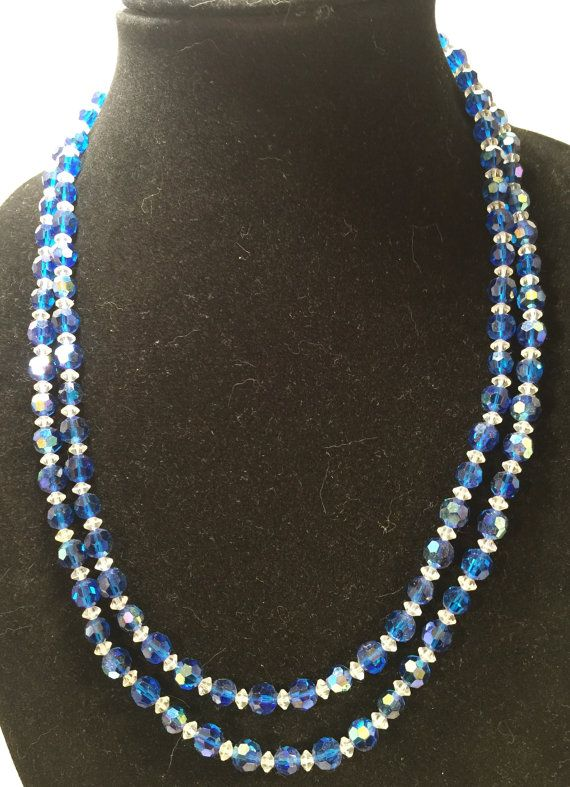 This Mad Men era necklace sparkles with sapphire and clear glass double stranded beads. It also has a stunning silver detailed clasp accented by