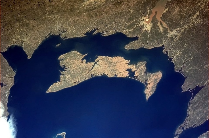 """Prince Edward Island from the ISS (International Space Station)--posted on April 29, 2013 by Col. Chris Hadfield in the ISS. He said: """"The red soil that makes Prince Edward Island's potatoes so famous is visible from space."""""""