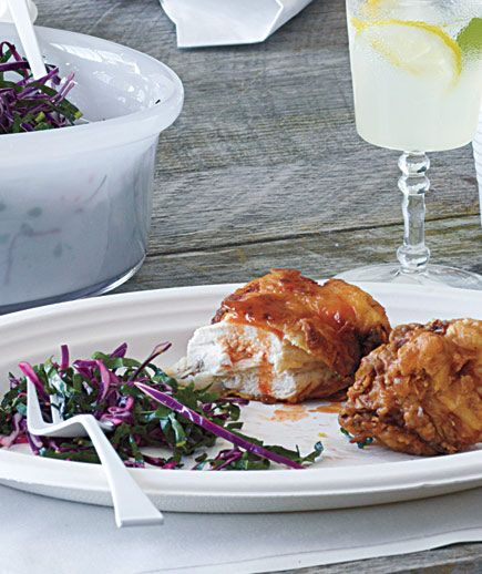 Spicy Fried Chicken With Kale and Cabbage Slaw: Marinate the chicken in a mixture of buttermilk and hot sauce to lock in moisture and add a spicy kick.
