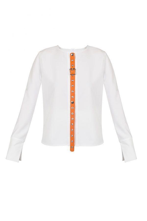 PIERRETTE SHIRT  The Pierrette shirt is a spectacular piece for being impeccably stylish both at refined daytime meetings as well as for your evenings in the city. The white lightweight fabric and the loose fit will ensure you a pleasant feel, while the orange leather tie appliqué can catch all the attention around by ensuring you a sharp and sassy look.