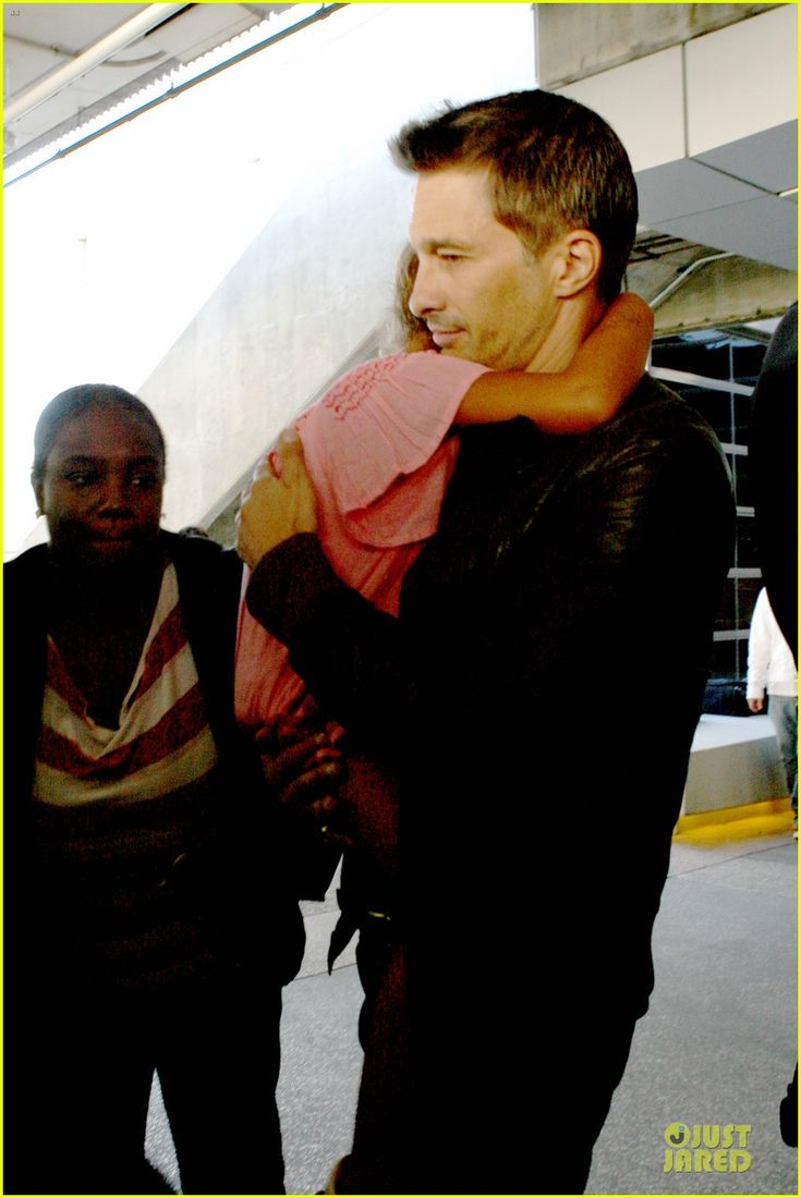 Halle Berry and Oliver Martinez arrive on a flight at LAX Airport with her daughter Nahla on July 16, 2013
