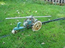 Sears Roebuck and Co. traveling tractor sprinkler.