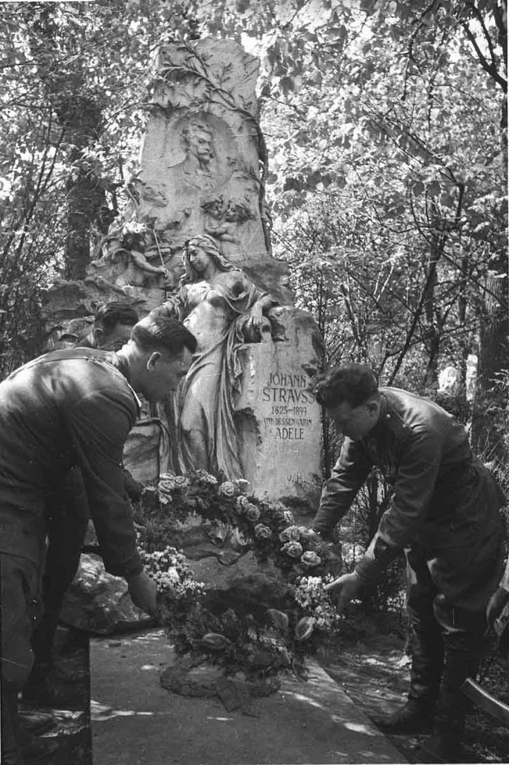 Outside war: Soviet officers leave a wreath of flowers at the grave of famed Austrian composer Johann Strauss, 1945.