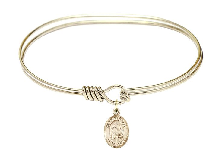 "7 inch Oval Eye Hook Bangle Bracelet w/ St. Raphael the Archangel medal charm. 7 inch Oval Eye Hook Bangle Bracelet with a St. Raphael the Archangel charm. St. Raphael the Archangel. 100% Handmade in the United States, Lifetime No-Tarnish Guarantee. Gold-Filled Medal. Brass bangle with ""Hamilton Gold"" gold plating."