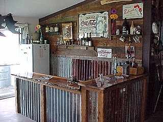 Man cave bar. Use of wood to cover up the seams on the tin.
