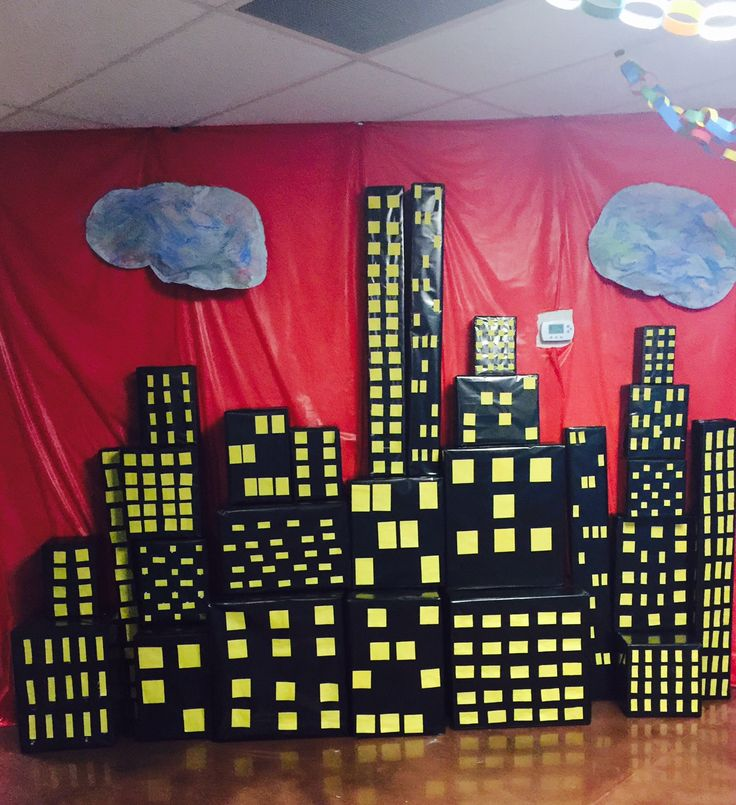 It starts with simple boxes! Ask members to donate all sizes of boxes to create your 3D cityscape scenes! Cover boxes with black paper. These were covered with black wrapping paper. Windows were created using yellow construction paper and glue. (One church used yellow sticky notes as an EZ tip!) Places completed boxes all throughout your hallways and rooms. cokesburyvbs.com