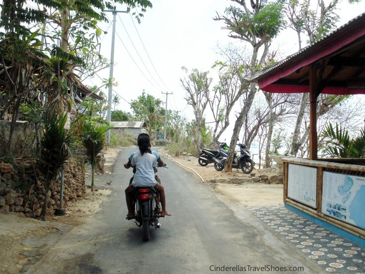 Chidren drive the motobike in Indonesia