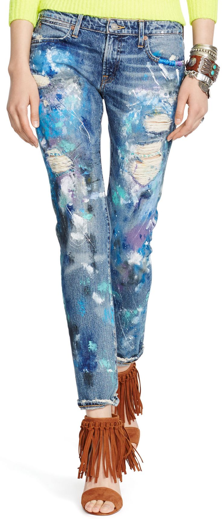Paint-splattered denim from Polo Ralph Lauren: With a slim boyfriend silhouette that tapers slightly at the cuffs, this Astor jean is made from lightweight denim that's paint-splattered, ripped and repaired for a lived-in look. It brings an artful vibe to any ensemble.