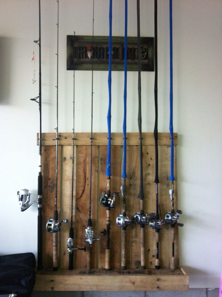 My pallet fishing rod holder pallet projects pinterest for Wooden fishing pole holder