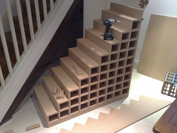 MDF wine rack, built into the staircase