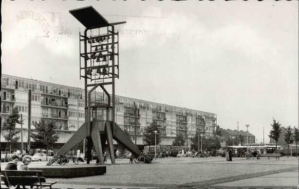 1960's. View on Plein '40-'45 with the Vrijheidscarillon (Liberty Carillon) at the Slotermeerlaan in Amsterdam. Plein '40-'45 is the main square of the Slotermeer section of Amsterdam Nieuw-West. The square was named in 1955 and recalls the years of German occupation from 1940 to 1945 during WW II. The most notable architectural landmark on the square, since 1961, is the Vrijheidscarillon. From Tuesday till Saturday there is a day market on the square. Photo Hema. #amsterdam #1960 #Plein4045