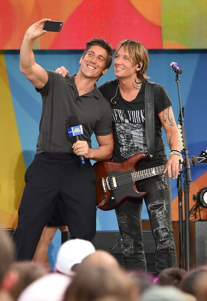 "Keith Urban Photos Photos - ABC's news anchor David Muir and Keith Urban pose on ABC's ""Good Morning America"" at SummerStage at Rumsey Playfield, Central Park on August 12, 2016 in New York City. - Keith Urban Performs On ABC's ""Good Morning America"""