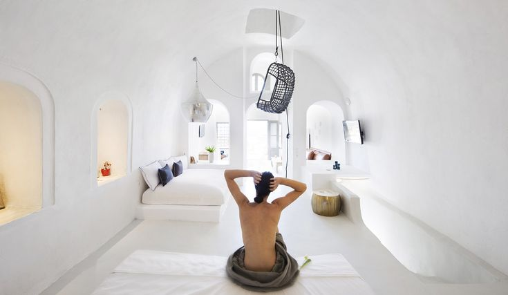 White bedroom with hanging chair