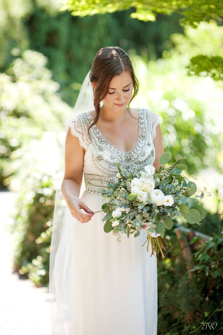 bride wearing Anna Campbell during Kelowna wedding photos captured by Tara Whittaker Photography | Kelowna, British Columbia