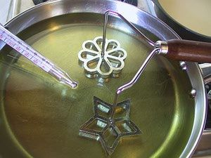 Illustrated step-by-step instructions for making Scandinavian rosette cookies.: Heat Your Oil