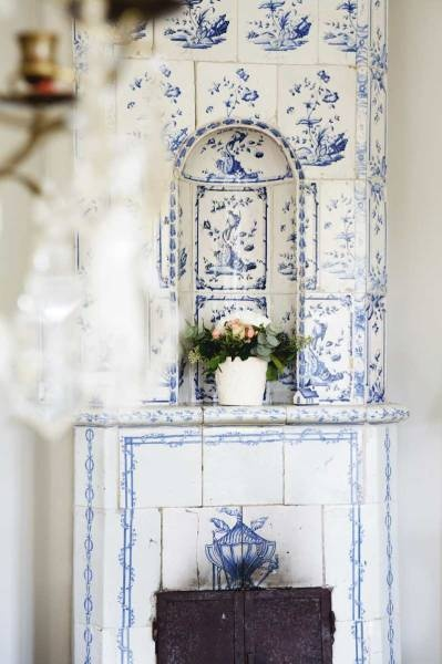 Pretty delft tile stove.: