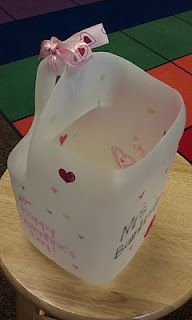 OMG, what a brilliant idea to use milk jugs to hold valentines (and Halloween treats!)- I mean, we go through at least one gallon a day so it would be easy to collect.