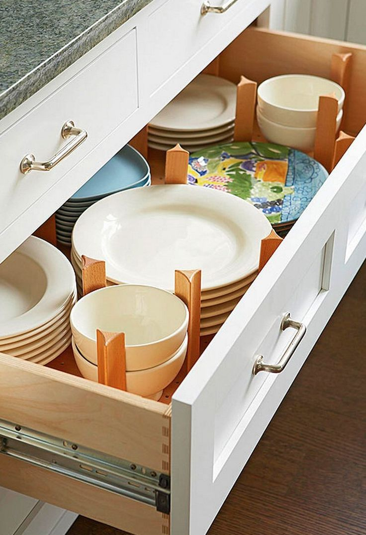 How do you store your dishes? It's probably most common to keep plates, bowls, and cups in overhead cabinets, but if I had the option, I think I'd much prefer a deep drawer, particularly one that's divided by a few wooden dowels, like you see here. Neat, organized, and generally easier to lift a bunch of plates out rather than get those plates down. What about you? Do you have deep drawers in your kitchen?
