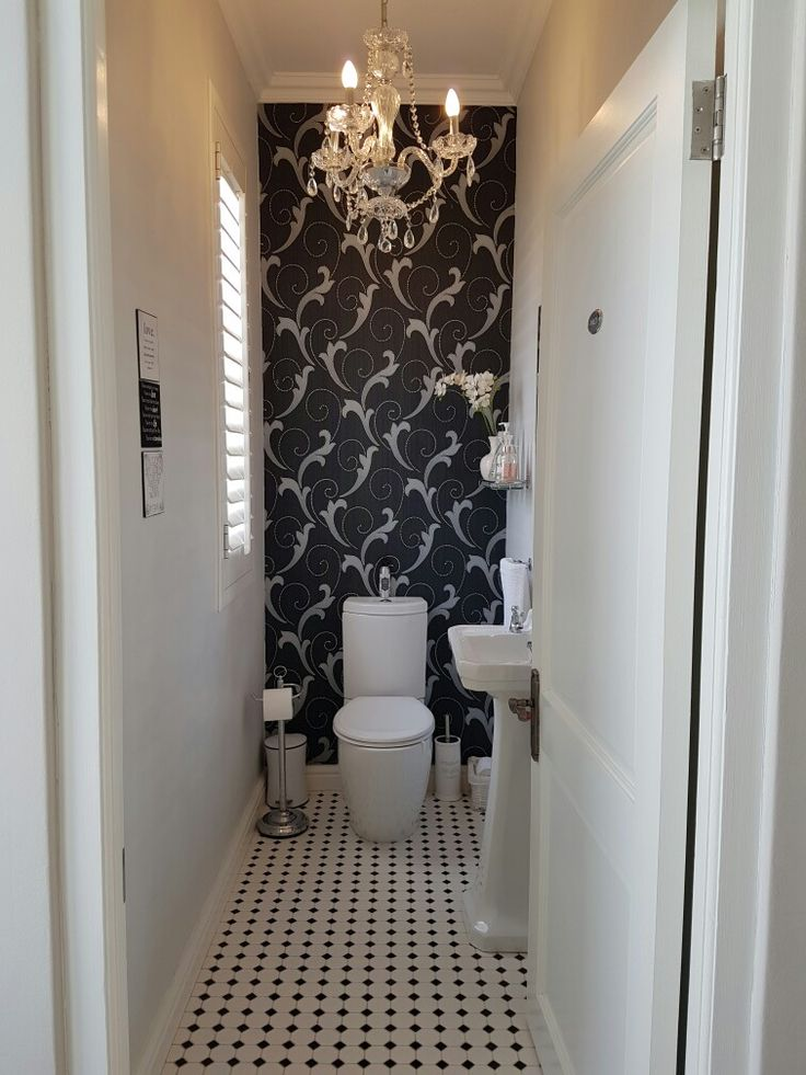 Guest toilet with mosaic tiles and wallpaper