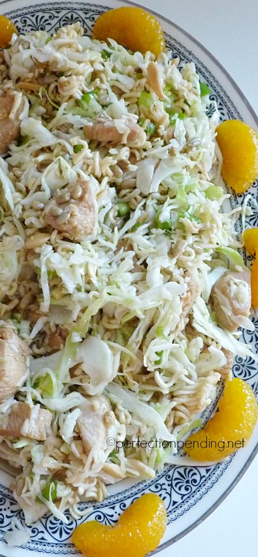 Crunchy Asian Chicken Salad. A perfect light summer dinner with cabbage, ramen noodles, sunflower seeds, and a yummy dressing!!