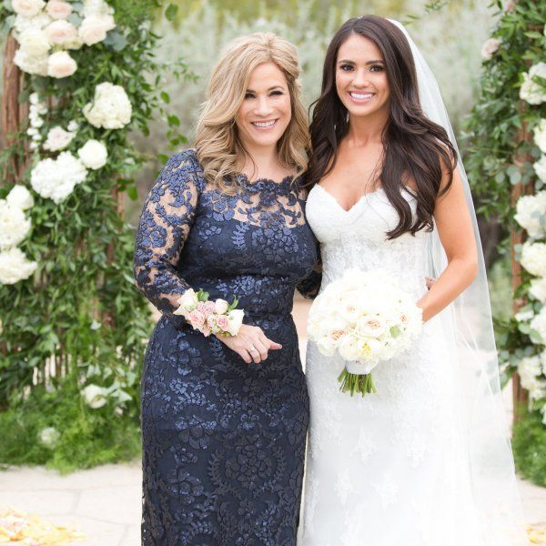 Dark colored mother of the bride dresses are really appropriate for any season.  This navy blue colored gown was made with a pretty lace pattern. We can produce long sleeve #motherofthebridedresses like this for you with any change you need to make it special for you. We are in the USA near Dallas Texas but can assist #motherofthebride clients from any where in the world. Contact us directly for pricing and more details on our process from our main website
