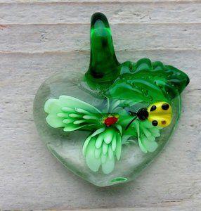 glazen ketting hanger met lieveheersbeestje