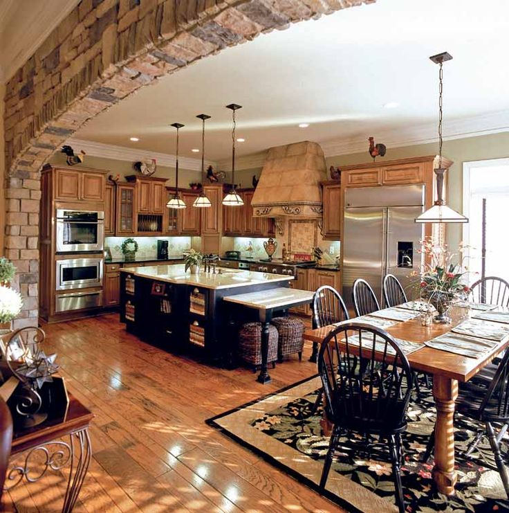 I've been obsessing over kitchens lately. Love anything with an open floor plan.