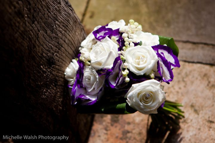 White rose and purple edged lisianthus bouquet