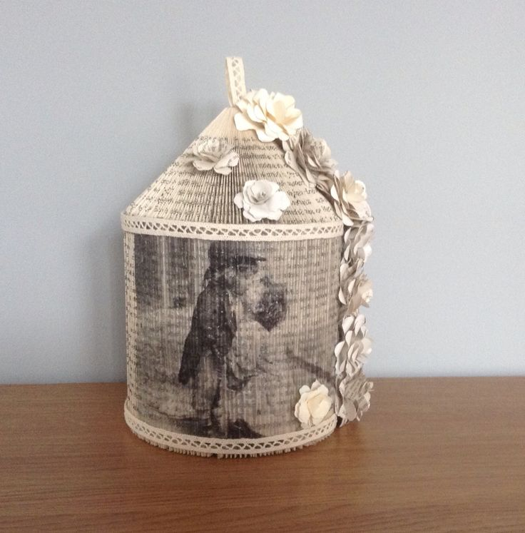 Book folded birdcage, decorated with napkin https://www.facebook.com/Tinasgiftstall2015