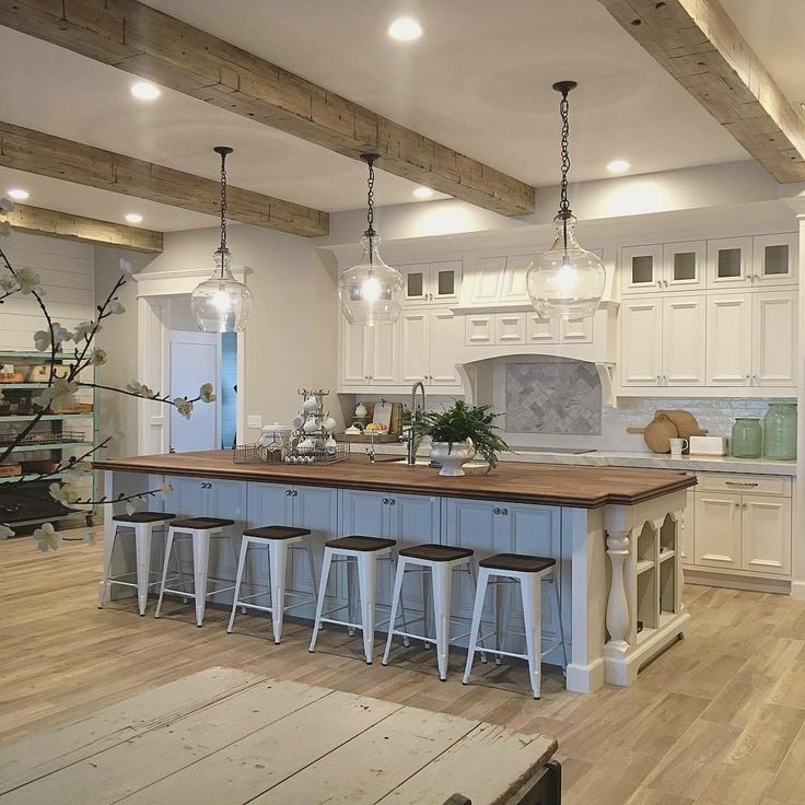 Pottery Barn We're kind of obsessed with this gorgeous kitchen from Instagrammer @nikki_grandy! Three of our oversized Flynn Recycled Glass Pendants fit beautifully into the space, which is any entertainer's dream. Way to go, NikkI! ❤️ http://pbsoci.al/61878u6hc
