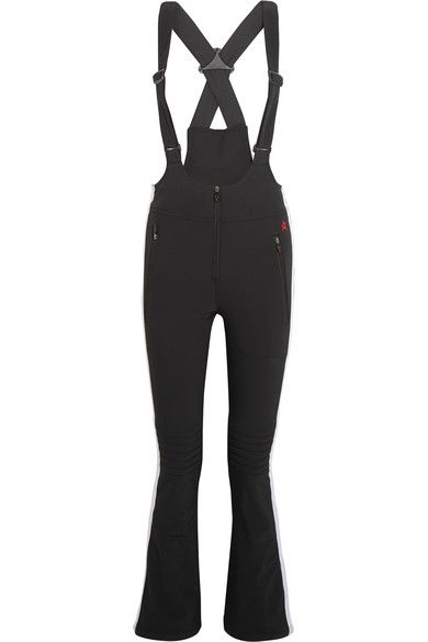 Perfect Moment's 'Racing' ski pants nod to the brand's retro heritage and '70s style. Crafted from insulating black shell in a salopette silhouette, this slim-fitting pair is detailed with streamlining side stripes and protective quilting at the knees. Leave the cuffs unzipped over your boots to create a flared shape.