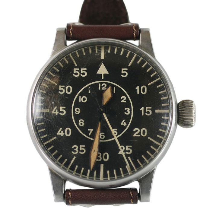 A.Lange & Sohne Military Watch Ref. FI 23883  German  1940s  A great example of a WWII Pilot's watch made by A.Lange & Sohne. This has a beautiful original Aviator's dial with a manual wind movement. It is made of a special non-magnetic alloy of nickel silver. The extra big case is fitted with a wide band which allowed the watch to be worn over the flight suit. In excellent condition. Circa 1940's.