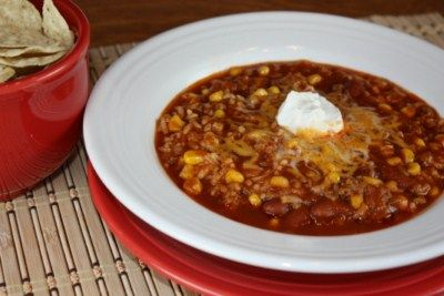 TACO SOUP.  Ingredients:  1 lb of ground beef; 1 onion, chopped; 1 green pepper, chopped; 48 ounce V-8, I use low sodium; 1 can corn, drained; 1 can of kidney beans, drained; 1 pkg of taco seasoning; 1 tsp of beef bouillon; 1  1/2 cups cooked rice.  Optional for serving:  cheese, sour cream, and tortilla chips.