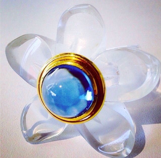 I used a clear high tech polymer and 18ct yellow gold with a blue topaz for this little beauty. Bespoke Blooms ... designed by markgold