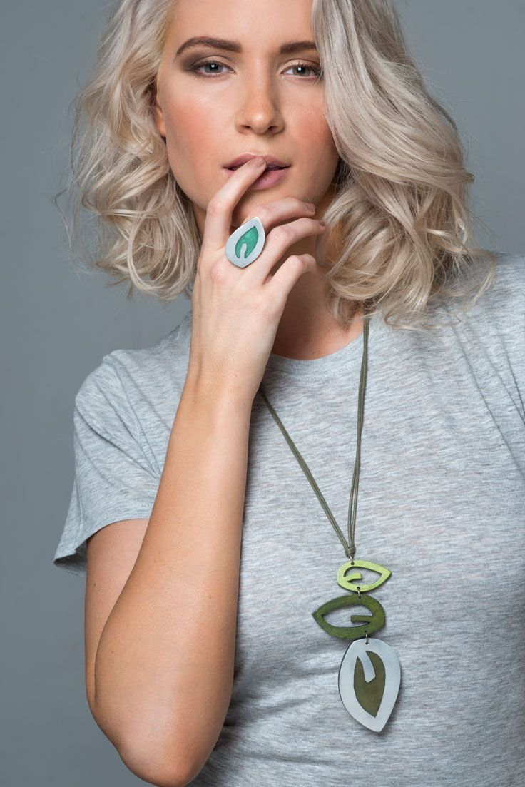 Gumnut necklace - Green. Contemporary, and unique our Gumnut necklace is simply stunning - perfect for any special occasion. It comes in two colours Green and Natural, and looks amazing worn with neutral block colours. Three irregular shaped leaves of resin, metal and wood drop elegantly from an adjustable cord. Teamed with our Riverstone earrings and rings, it is the perfect accessory for making a statement.