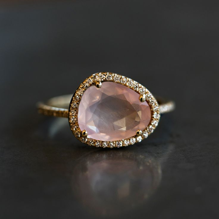 "14kt gold and diamond single band rose quartz ring *diamonds go halfway around the band *total diamond weight: .15ct *total rose quartz weight: 2.35 - 2.38ct ** ""The love stone,"" rose quartz works dir"