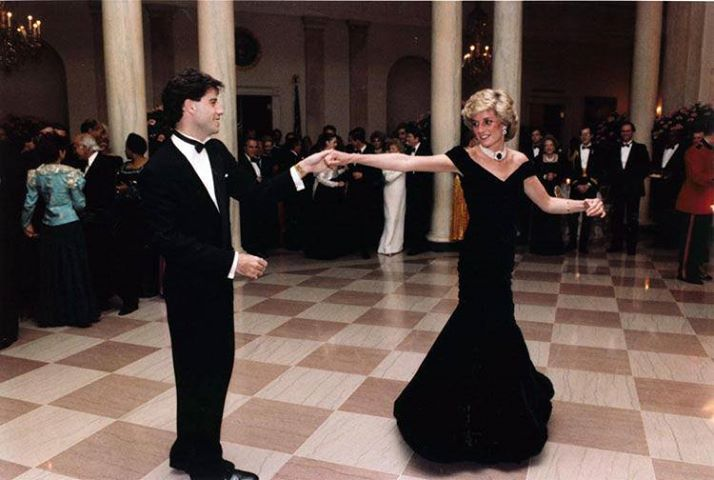 Princess Di and John Travolta c. 1985. Blue velvet by Victor Edelstein, pearl & sapphire choker, a gift from the Queen. Shop vintage gowns on www.chicstash.com #diana #ballgowns #dresses #princessdiana