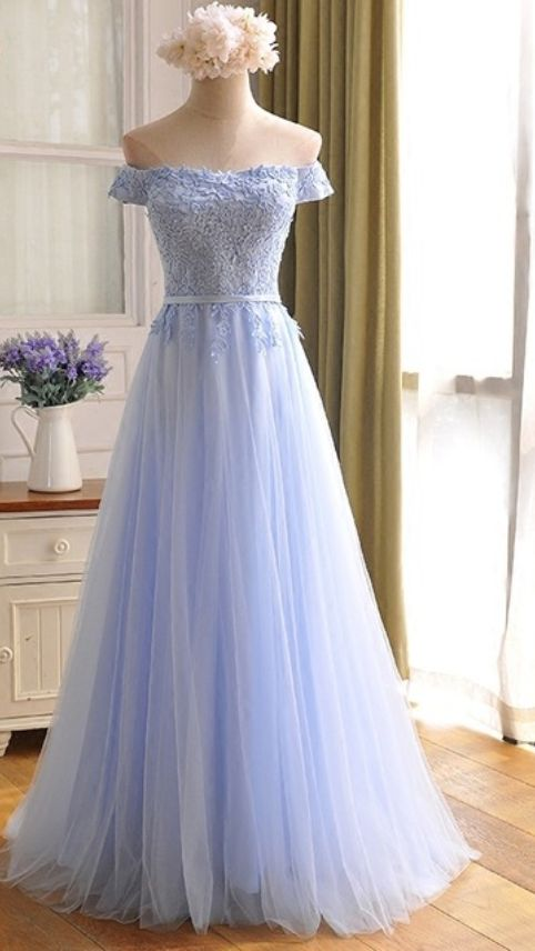 Blue light parties wear long skirts at night and the women in the back of the lounge chair dress in a formal PROM gown