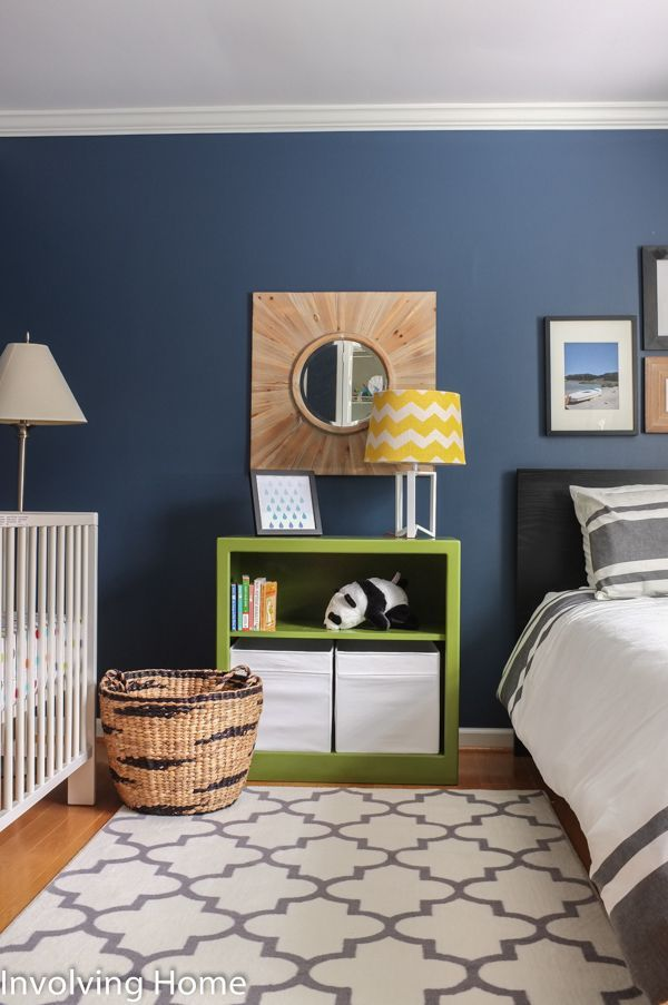 Navy, green, and gray boy's nursery ideas with natural wood accents and twin bed